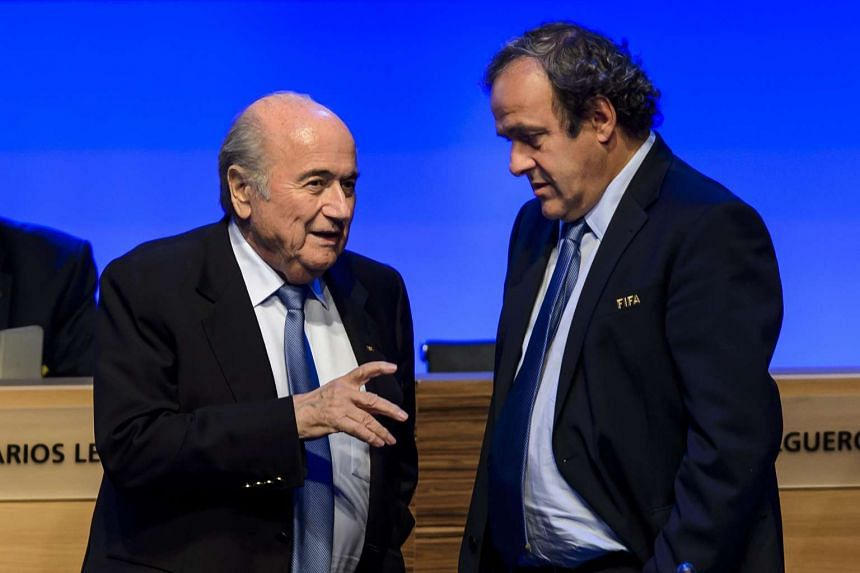 Sepp Blatter (left) and Michel Platini, seen in this 2014 file photo, have been suspended for 90 days by Fifa's ethics watchdog.