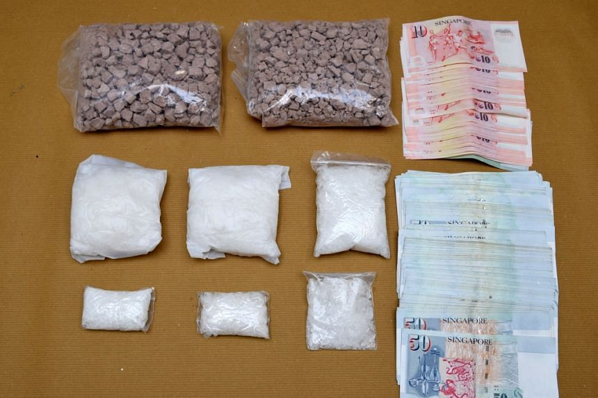 Drugs and cash that was seized during a CNB operation on Oct 6, 2015 are shown to the media.
