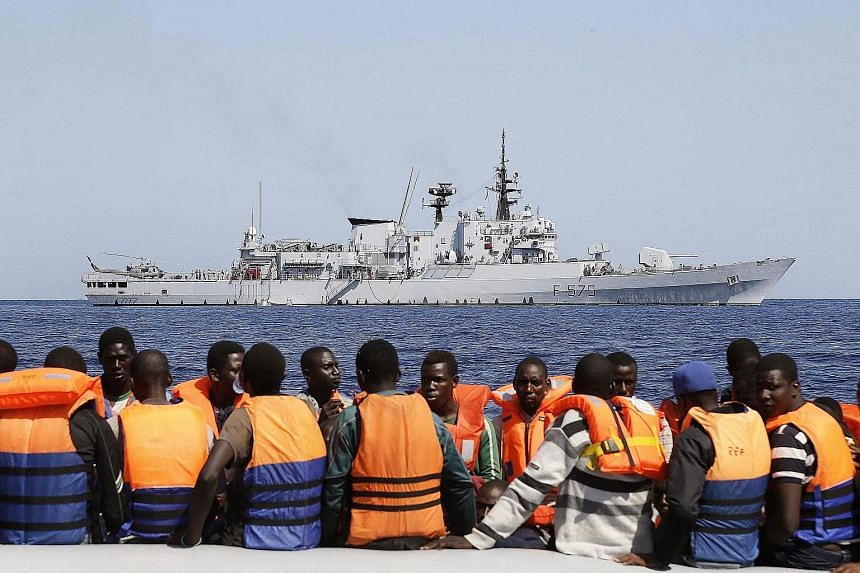 Sub-Saharan migrants being transported to an Italian Navy ship in the southern Mediterranean Sea last month.