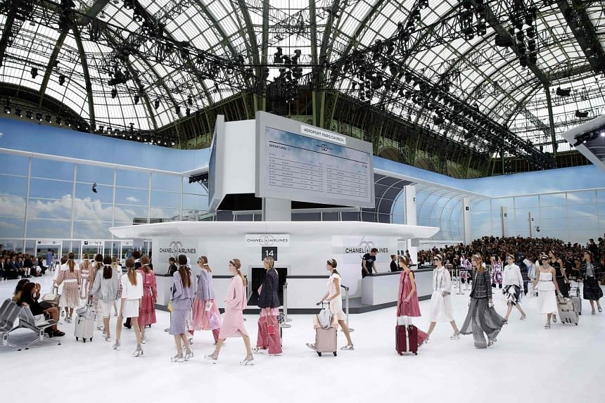 The Chanel spring/ summer 2016 collection is presented in a mock airport departure lounge (above), with Kendall Jenner as one of the models.