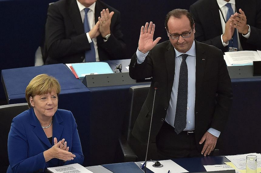 German Chancellor Angela Merkel and French President Francois Hollande at the European Parliament in Strasbourg yesterday.