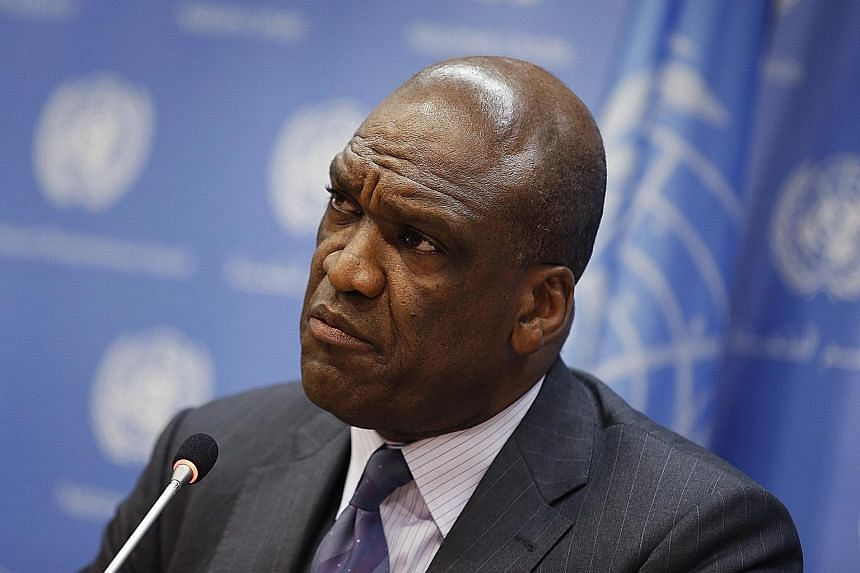 The allegations against John Ashe (above) are a widening of the investigation of Ng Lap Seng (left) who was arrested, along with an assistant, by Customs officials in New York last month and charged with bringing US$4.5 million (S$6.4 million) into t