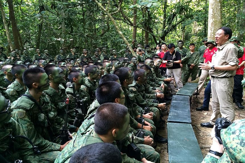 Deputy Prime Minister Teo Chee Hean meeting Singapore Armed Forces soldiers undergoing jungle training in Temburong, Brunei, yesterday. He was on a four-day visit that ended yesterday as part of the 3rd Young Leaders' Programme, jointly organised by