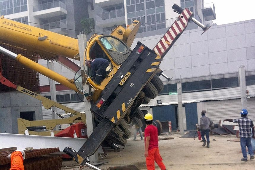 A crane toppled in Bedok on Tuesday, one of two incidents that day. There were 17 crane-related accidents in the first eight months of this year.
