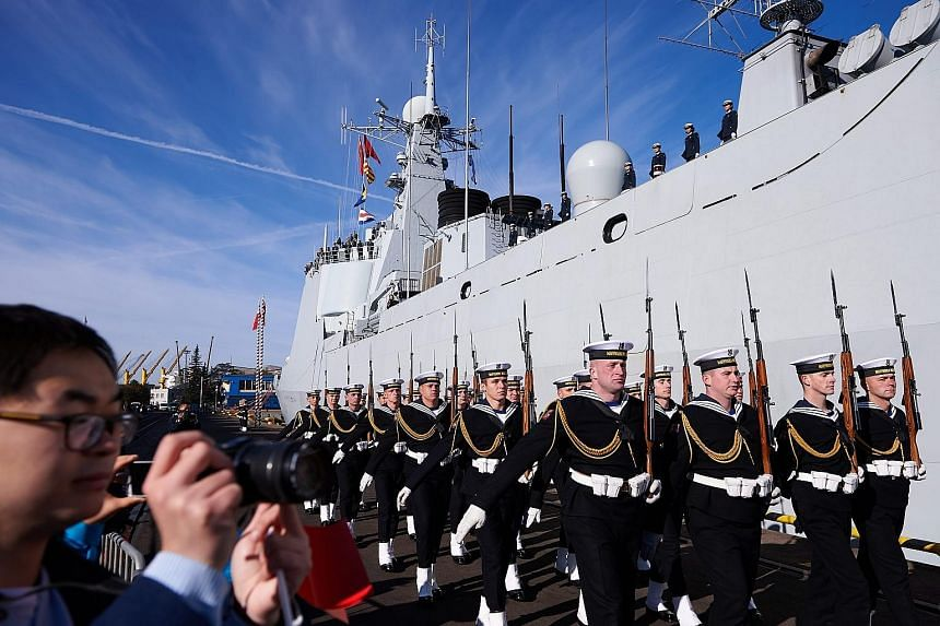 Polish Navy personnel marching at a welcome ceremony for Chinese Navy ships in the port of Gdynia in Poland yesterday. Three Chinese naval vessels - Jinan, a destroyer; Yiyang, a multi-role frigate; and Qiandaohu, a replenishment ship - sailed into G
