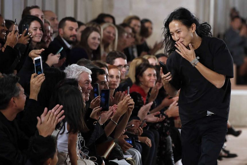 US fashion designer Alexander Wang (right) acknowledges the audience at the end of a fashion show on Oct 2 in Paris. Demna Gvasalia will succeed him as creative director of Balenciaga.