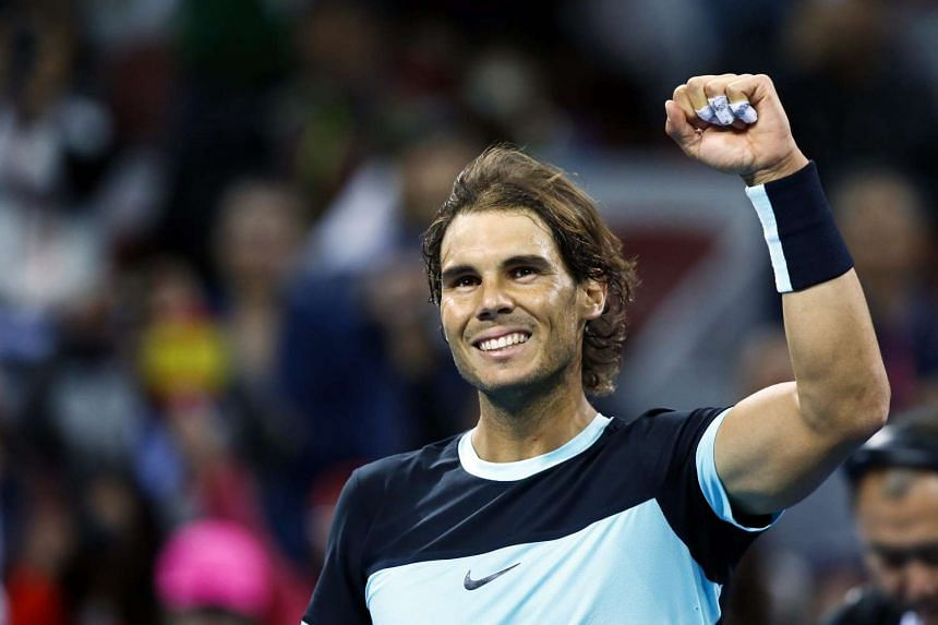 Rafael Nadal celebrating after beating Vasek Pospisil at the China Open on Oct 7.
