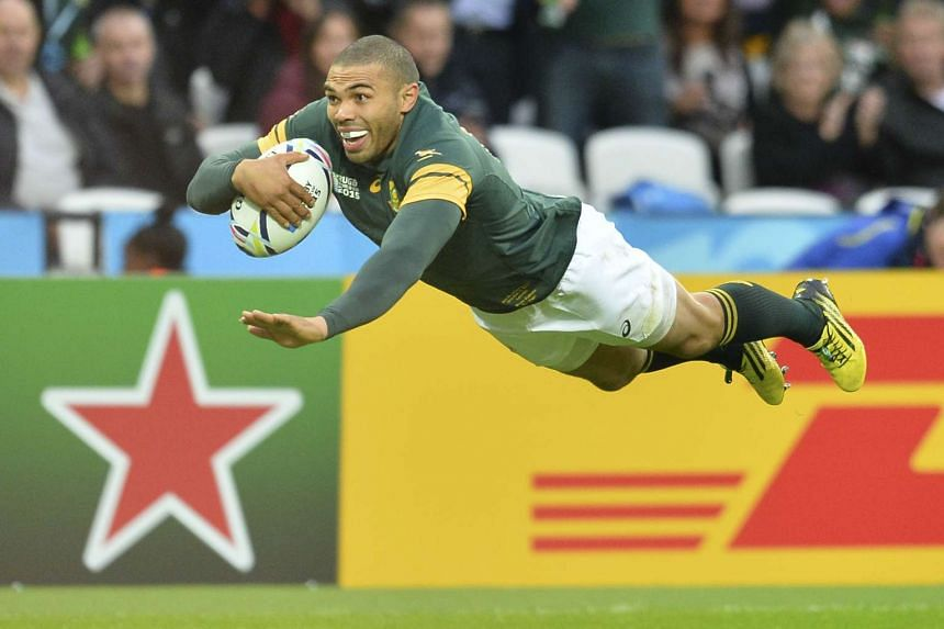 South Africa's wing Bryan Habana scores his team's second try.