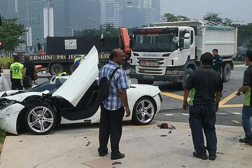 The aftermath of an accident involving a van, a motorcycle and a white sports car at the junction of Marina Boulevard and Bayfront Avenue.