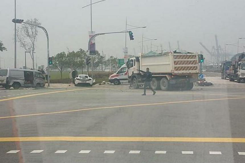 Tipper truck driver Mr Fahil stopped to help after a van crashed into a motorcycle and a white sports car at the junction of Marina Boulevard and Bayfront Avenue.