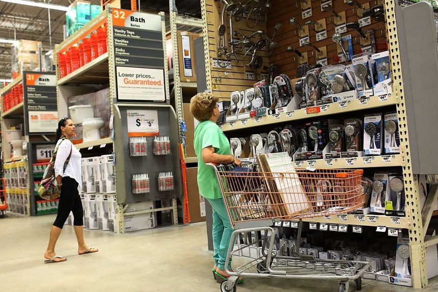 Customers shop at a Home Depot on August 18, 2015 in Miami, Florida.