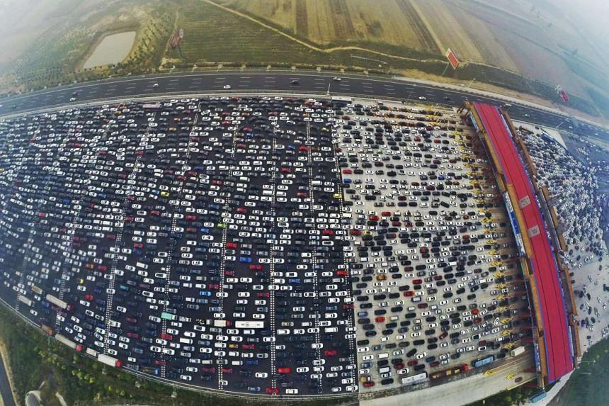 Scores of vehicles stuck near a toll station along the G4 Beijing-Hong Kong-Macau Expressway on Oct 6, 2015.