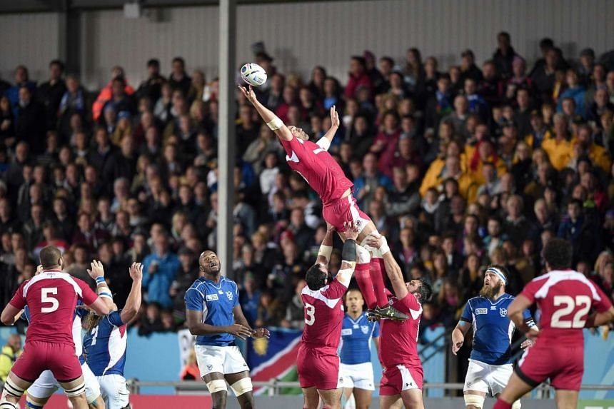 Georgia's No. 8 and captain Mamuka Gorgodze (centre) jumps for the ball in a line out.