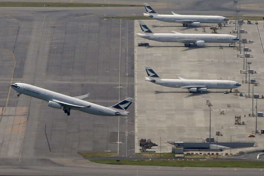 A Cathay Pacific Airways passenger flight takes off from Hong Kong Airport on June 12, 2015.