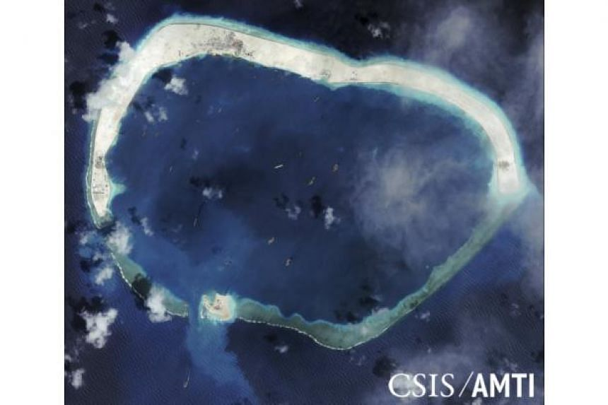 Mischief Reef, pictured in this handout satellite image, shows China's rising military pressence in the South China Sea.
