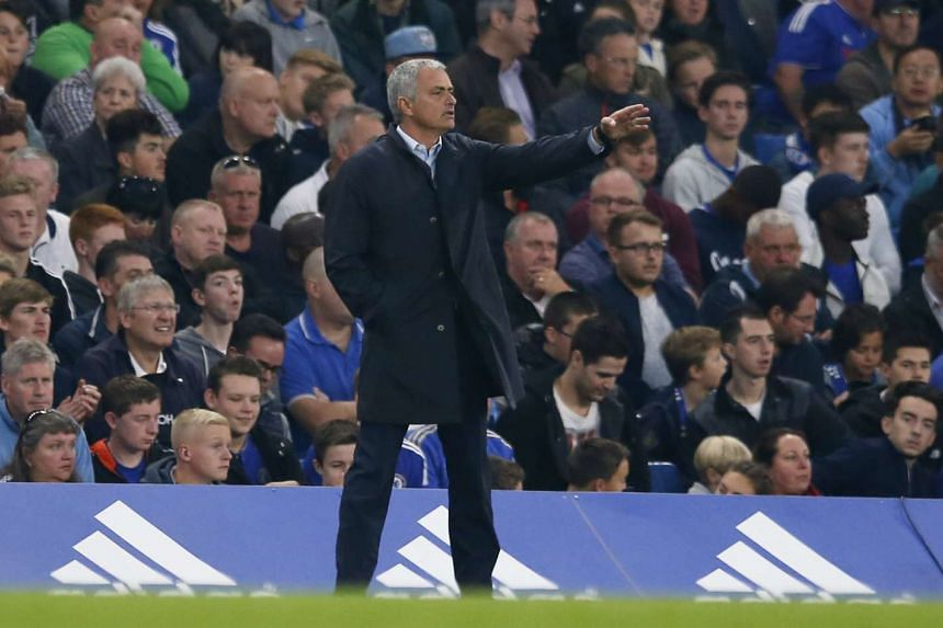 Chelsea manager Jose Mourinho shouts instructions from the sidelines during the English Premier League match against Southampton at Stamford Bridge on Oct 3, 2015.