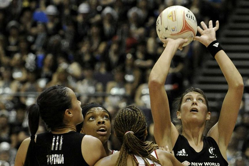 New Zealand's Irene Van Dyk (right) making a shot while England's Eboni Beckford-Chambers looks on at the World Netball Championship 2011 (WNC) held at the Singapore Indoor Stadium on July 9, 2011.