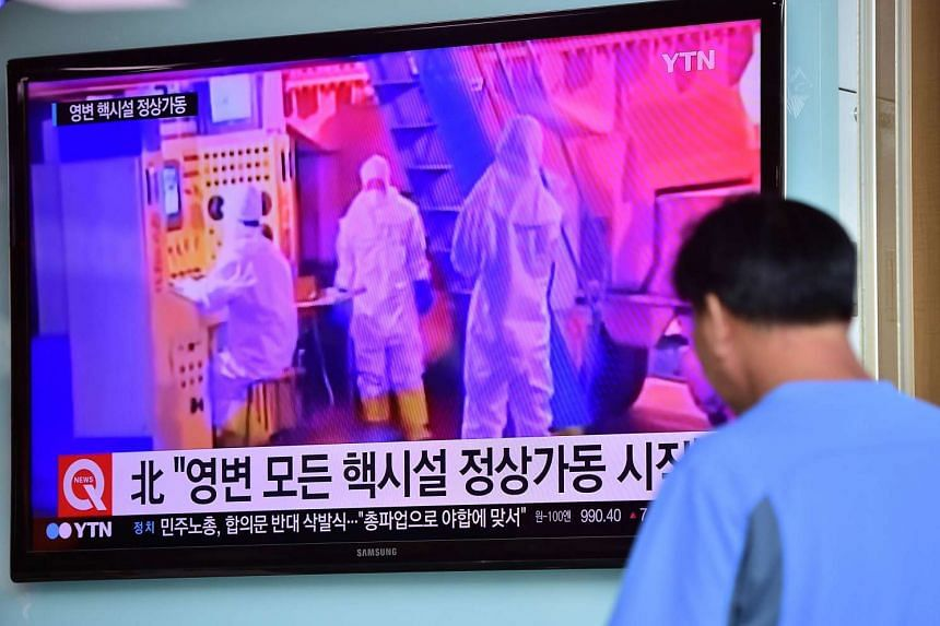 A man watches a news report at a railway station in Seoul on Sept 15, 2015, on the confirmation from North Korea that the nuclear reactor seen as the country's main source of weapons-grade plutonium had resumed normal operations.