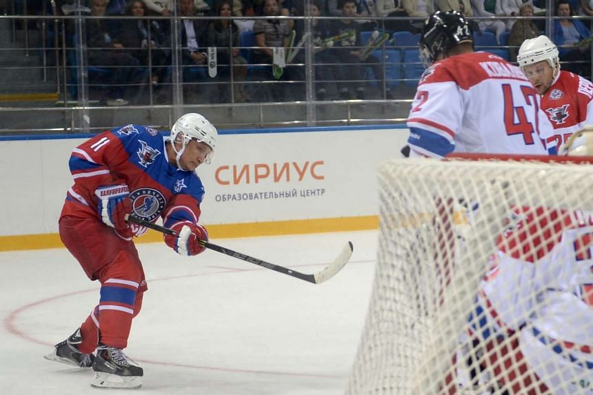 Putin takes part in a hockey match during the opening of a new season of the Night Ice Hockey League in Sochi.