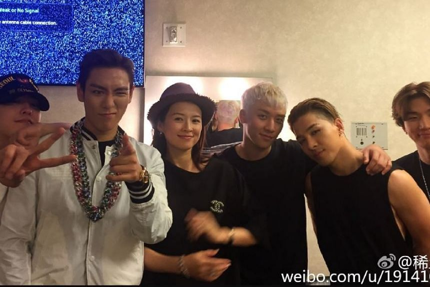 Actress Zhang Ziyi posted a picture of herself with members of K-pop group BigBang in Las Vegas, stirring up fresh talk that she is pregnant.