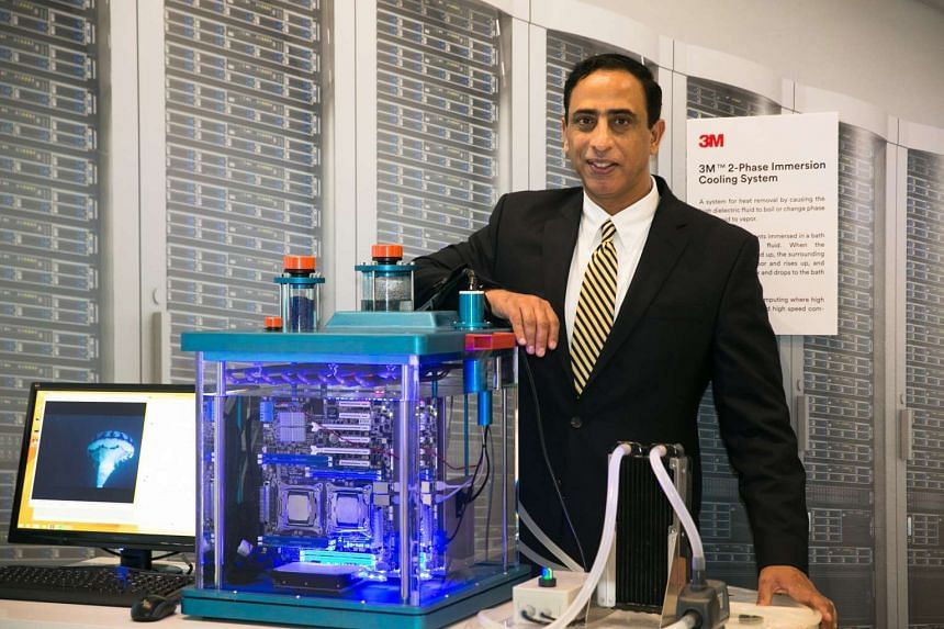 Dr Khandpur and one of the experiments at a 3M facility. The Smart Urban Solutions Lab based in Woodlands will have 10 engineers and scientists who can call upon the resources of 3M's 8,500-strong global research team.