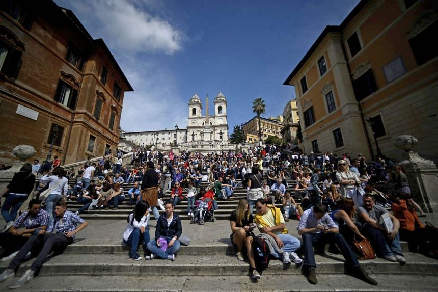 Tourists sitting on the Spanish steps in downtown Rome in 2012.
