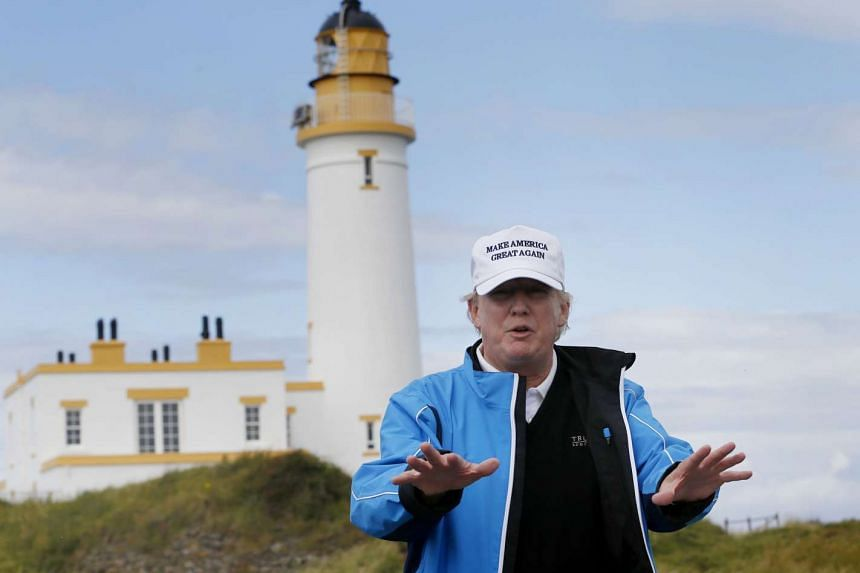 Trump (above) says plans for 11 offshore turbines will spoil the view from his greens.
