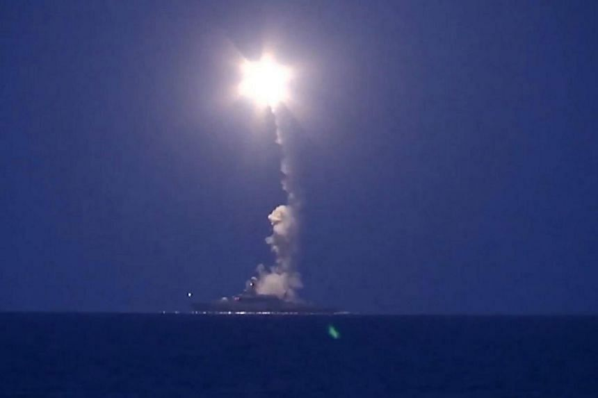 A warship of the Caspian Flotilla launching missiles taken from a video footage made available on the Russian Defence Ministry's website.