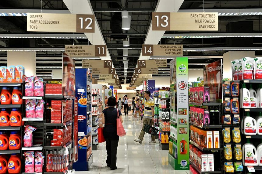 Customers at a Cold Storage outlet at Great World City.