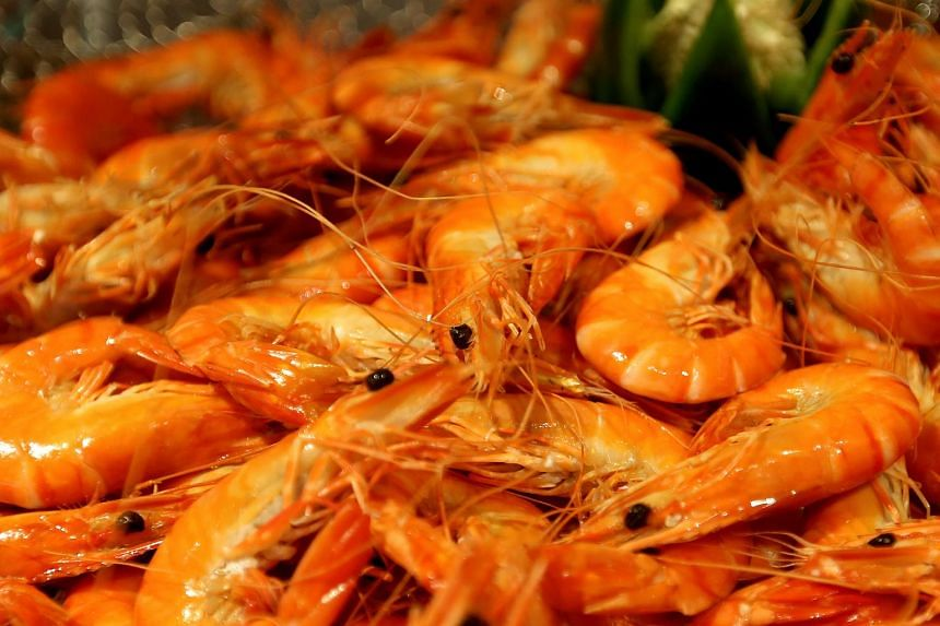 """A restaurant in Qingdao has been fined 90,000 yuan (S$19,900) for misleading consumers over what has been dubbed the """"38 yuan large prawn"""" scandal, which has sparked a public outcry online."""