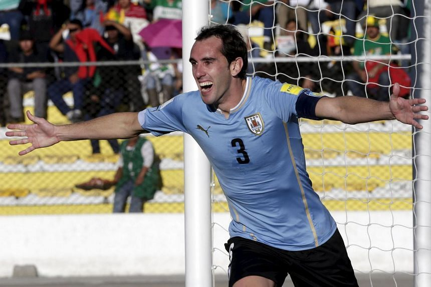 Diego Godin of Uruguay celebrating after scoring against Bolivia during their 2018 World Cup qualifying match in La Paz.