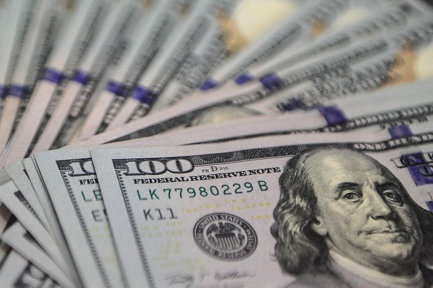 The US dollar slid against all but one of its 16 major counterparts after minutes from the Fed's meeting last month showed officials discussed how the strong US currency was damping inflation and exports.