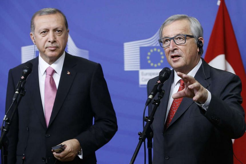 European Commission President Jean Claude Juncker (right) speaks to the media as he welcomes Turkish President Recep Tayyip Erdogan at the EU Commission in Brussels, Belgium, Oct 5, 2015.