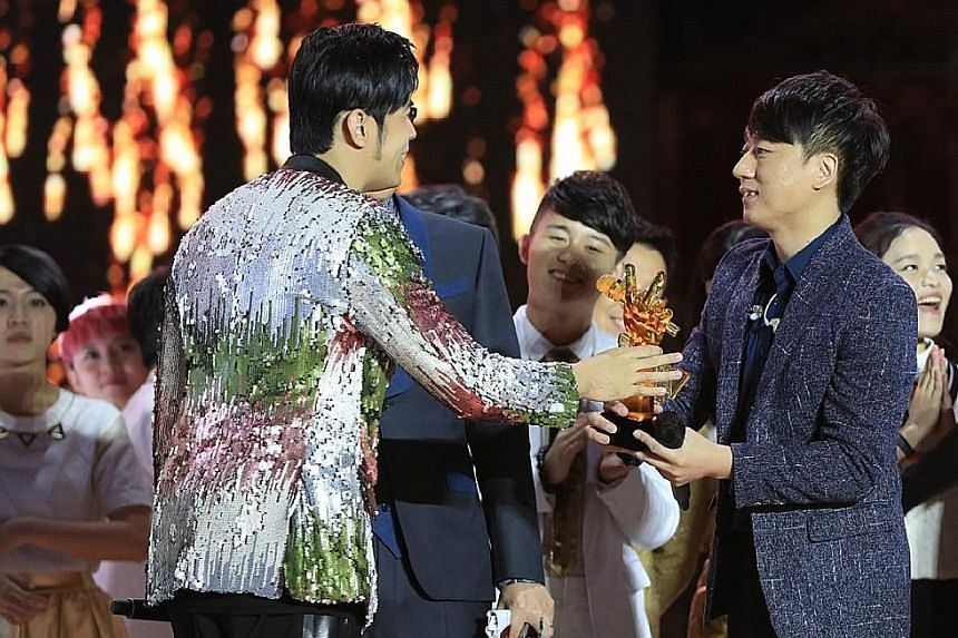 Jay Chou congratulating Na Ying's protege, Zhang Lei, who won The Voice Of China.