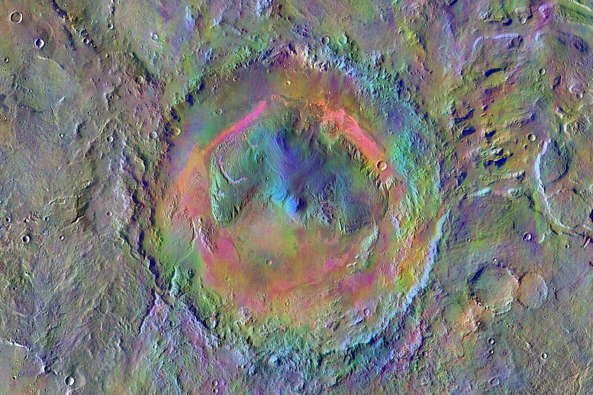 A mosaic image made using data from the thermal emission imaging system on Nasa's Mars Odyssey orbiter. Windblown dust appears pale pink and olivine-rich basalt looks purple. Dark, narrow, 100m-long streaks (above) called recurring slope lineae flowi