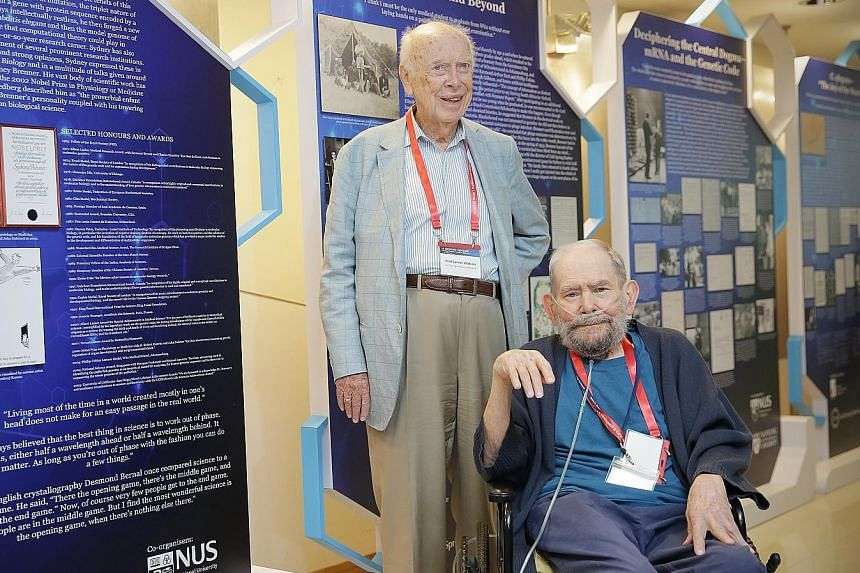 Dr James Watson (left) and Dr Sydney Brenner at the Sydney Brenner Scientific Symposium and Exhibition, which features Nobel laureate Brenner's journey in science and his major accomplishments.