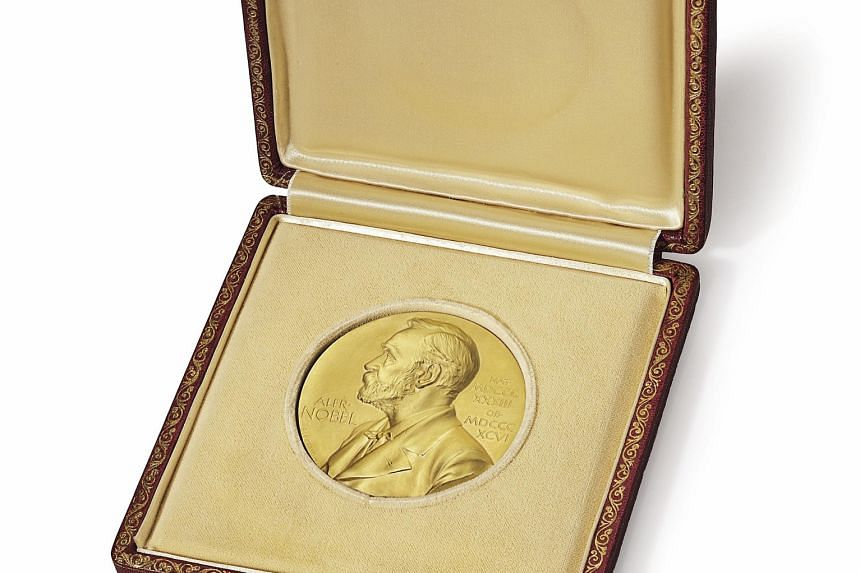 Dr James Watson's Nobel medal, which was put up for auction on Christie's.