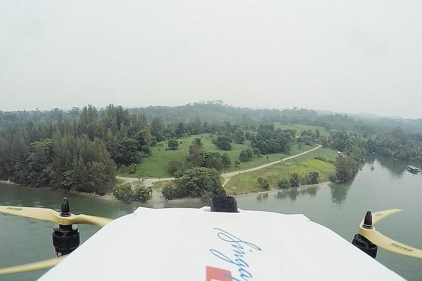 View from the SingPost drone during its successful delivery trial on Sept 25. It flew 2km, between Lorong Halus and Pulau Ubin, carrying a letter and T-shirt in a packet. The drone prototype has safety features designed for dense urban areas.