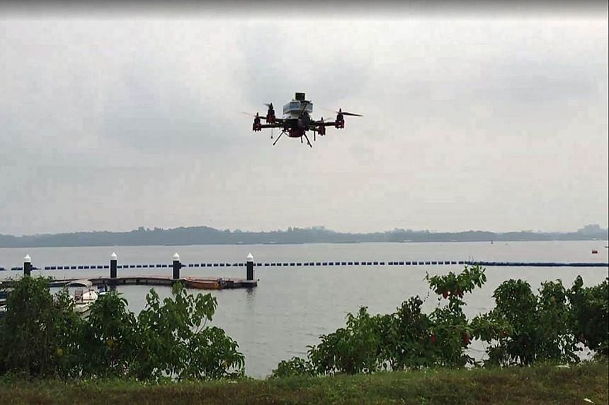 A SingPost drone prototype on a delivery trial on Sept 25, which was touted as the world's first successful test by a postal service provider. The drone flew 2km between Lorong Halus and Pulau Ubin, carrying a letter and a T-shirt in a packet. It has