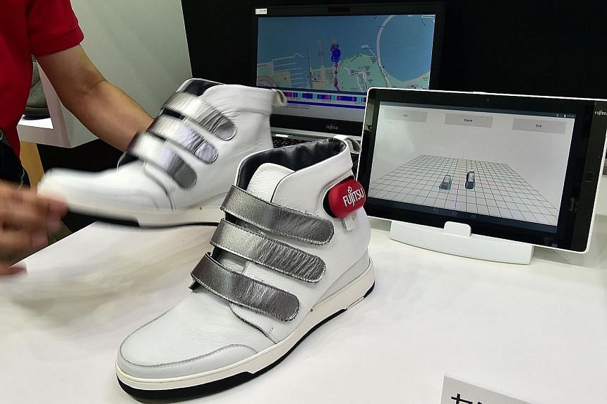 """Left: The DJI Phantom 3 drone by SZ DJI Technology. Below: Computer giant Fujitsu's """"Retissa"""" retinal imaging eyewear can project digital images onto a user's retina using laser beams. It is useful for low-vision patients."""