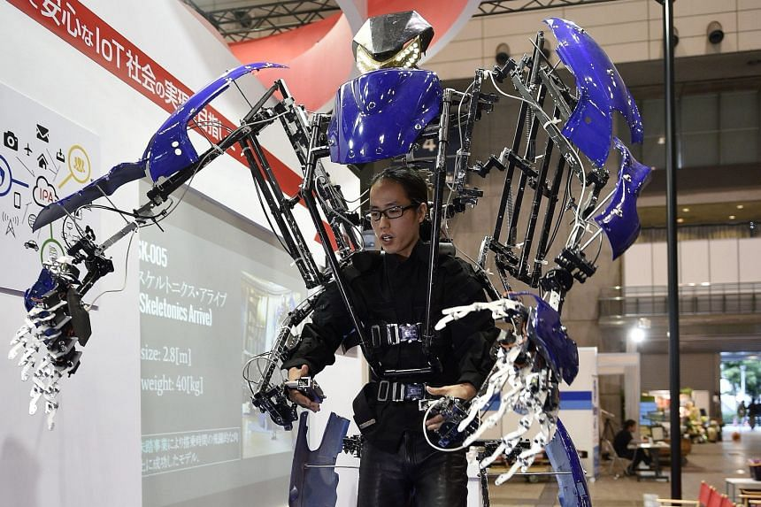 A man testing a Skeletonics robot suit that extends the movement of human arms and legs. Besides smart gadgets and appliances, robots were also key attractions at the show.
