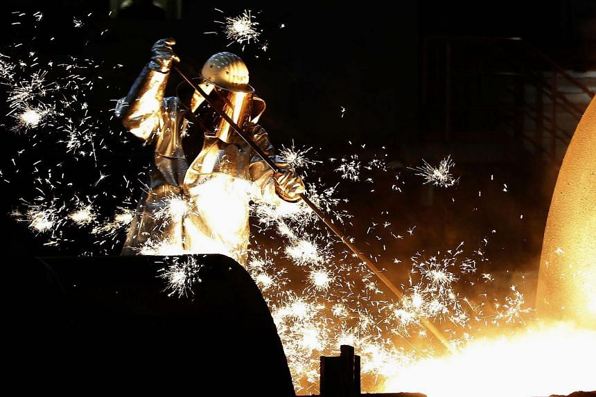 Sparking off the drop were a slowdown in China, Germany's third-biggest trade partner, as well as in other emerging markets that have been key destinations for German exports. At left is a worker in a steel factory in the western German city of Duisb