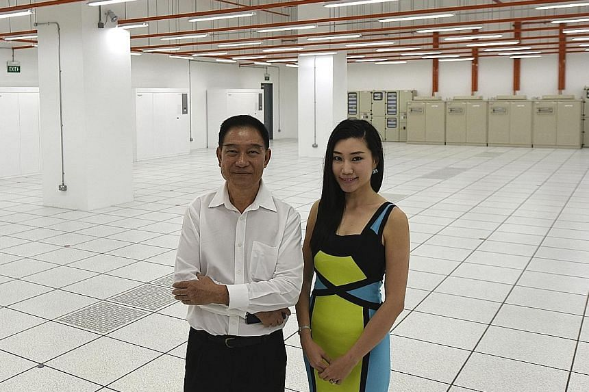 Mr Sok Hang Chaw, Kingsland Development founder and chairman, and the company's executive director Shann Sok Aixuan at the Jurong data centre. Security features include a man-trap with biometric palm reader (below) and many closed-circuit TV cameras.