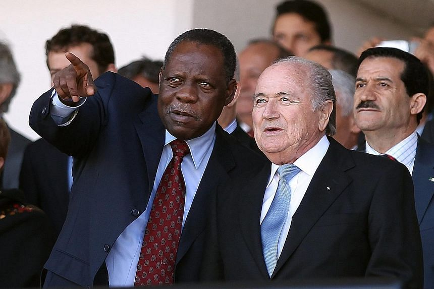 Cameroon's Issa Hayatou (left, in a 2012 picture) will now serve as the acting president of Fifa, replacing Sepp Blatter, who has been slapped with a 90-day ban by Fifa's Ethics Committee.