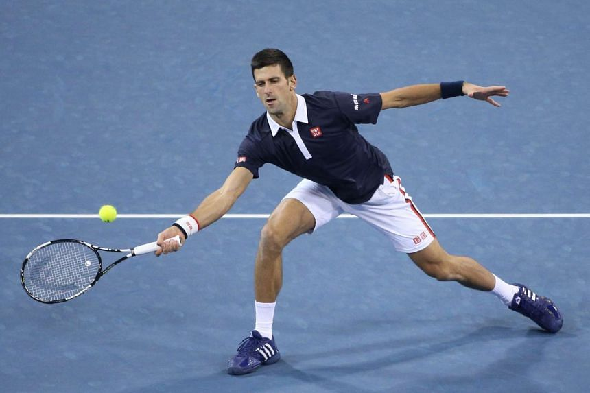 Novak Djokovic of Serbia in action during the doubles' match with brother Djordje Djokovic (not pictured) against Vasek Pospisil of Canada and Jack Sock of the US during the China Open in Beijing on Oct 8.
