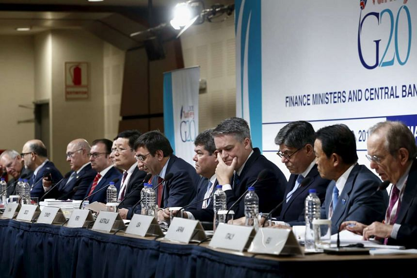 G-20 finance ministers and central bank governors give a news conference at the 2015 IMF/World Bank Annual Meetings in Lima.