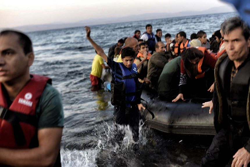 Refugees and migrants arriving at the Lesbos island after crossing the Aegean Sea from Turkey on Oct 8, 2015.