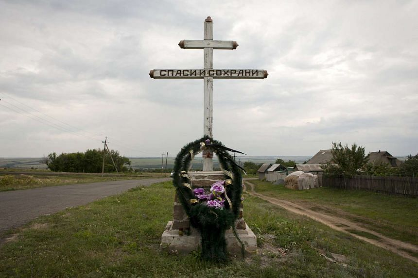 A memorial next to the site of downed Malaysia Airlines flight MH17, near the village of Hrabove in Ukraine's Donetsk region.