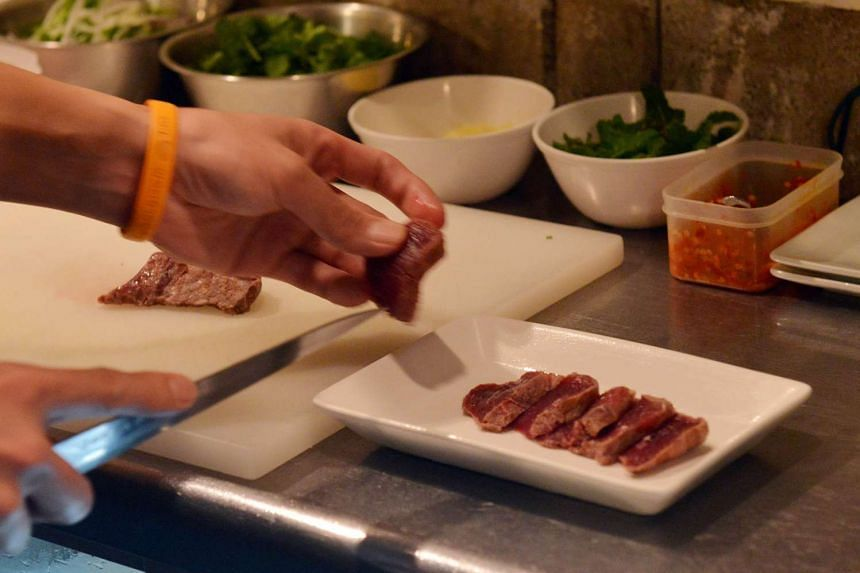Chef Eiichi Tsuchiya preparing whale meat carpaccio at his restaurant in Tokyo for the Ebisu whale meat festival.