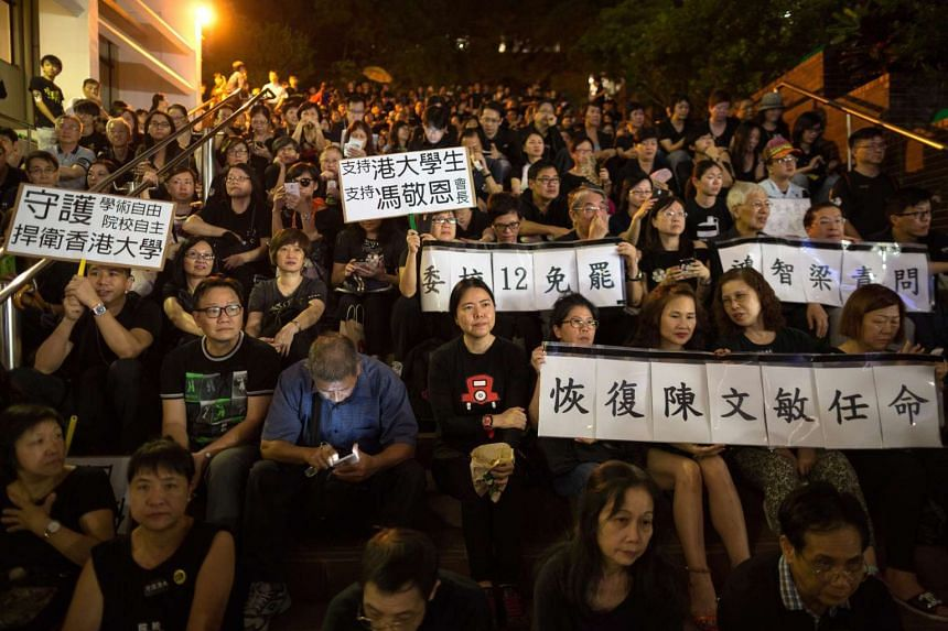 Hong Kong University students, faculty members, staff and alumni gather on their campus to protest against what they perceive to be interference in the university's autonomy, in Hong Kong, China.